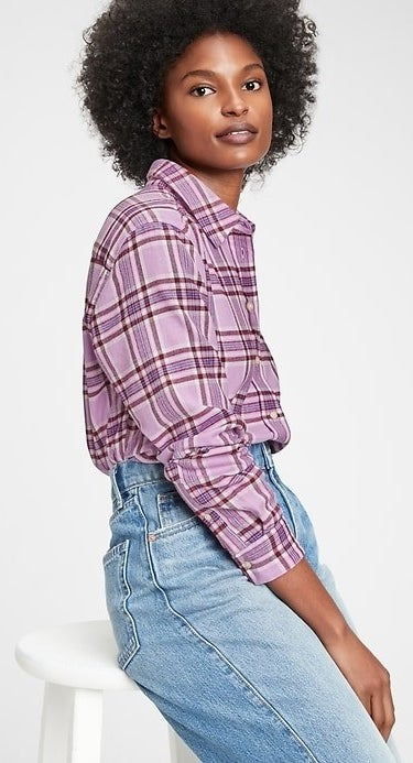 Model wearing purple flannel