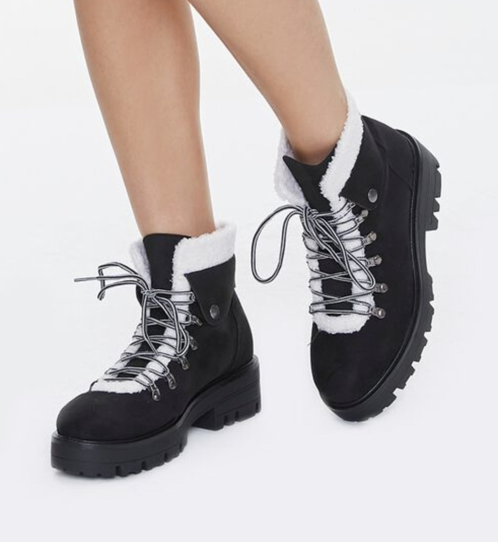 Model is wearing black ankle boots