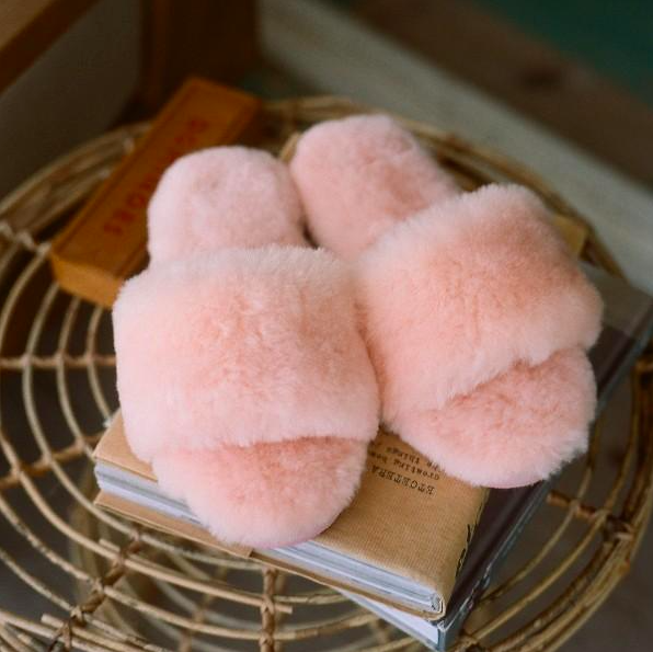 A pair of fluffy slippers on a coffee table