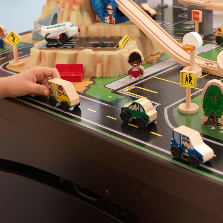 close up shot of a kid playing with a toy train set