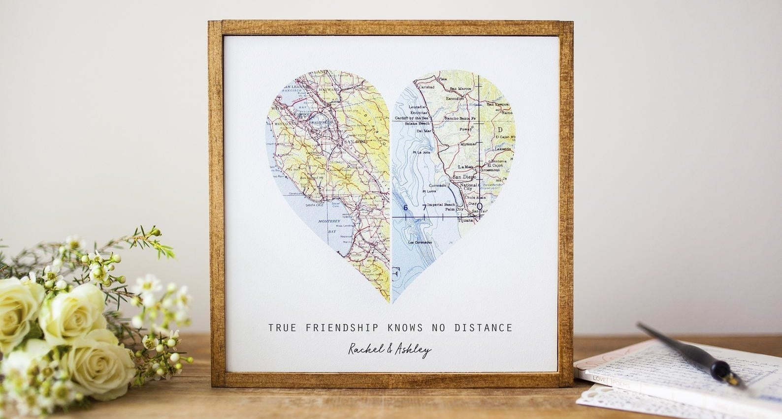 """A framed heart shaped map that says """"True friendship knows no distance. Rachel and Ashley"""""""