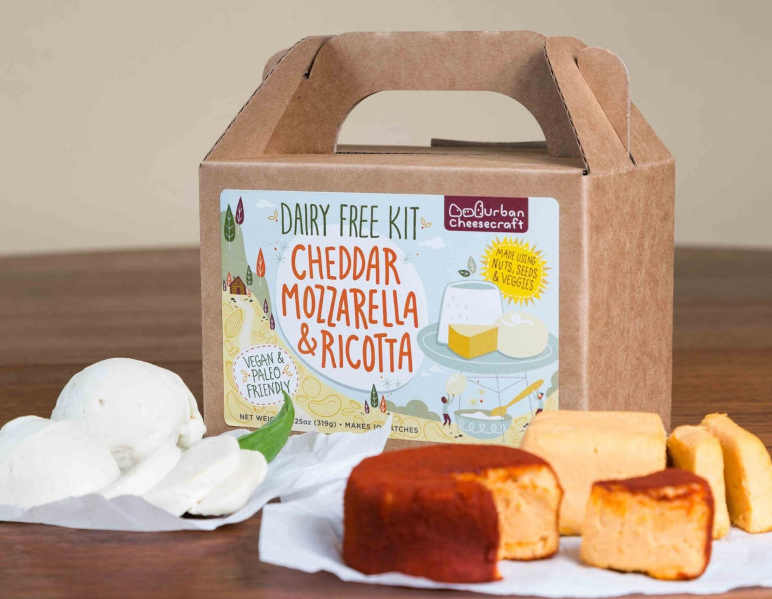 the dairy free cheese kit package next to plated cheeses