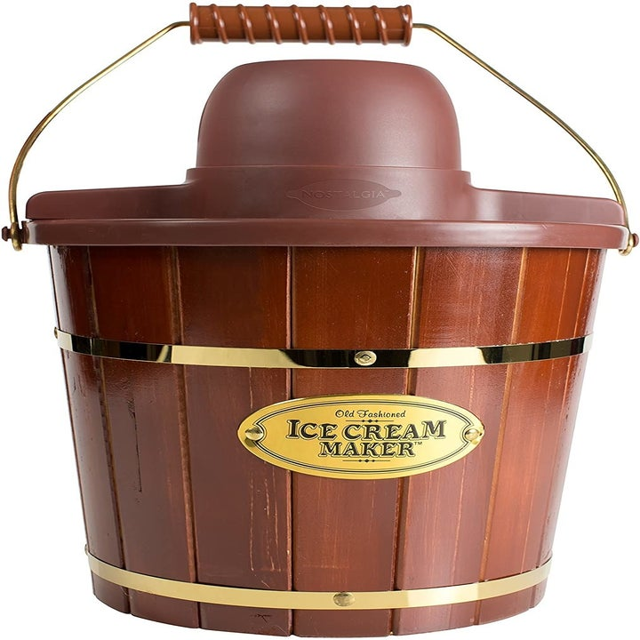 """the brown wooden maker with a gold label that says """"ice cream maker"""""""
