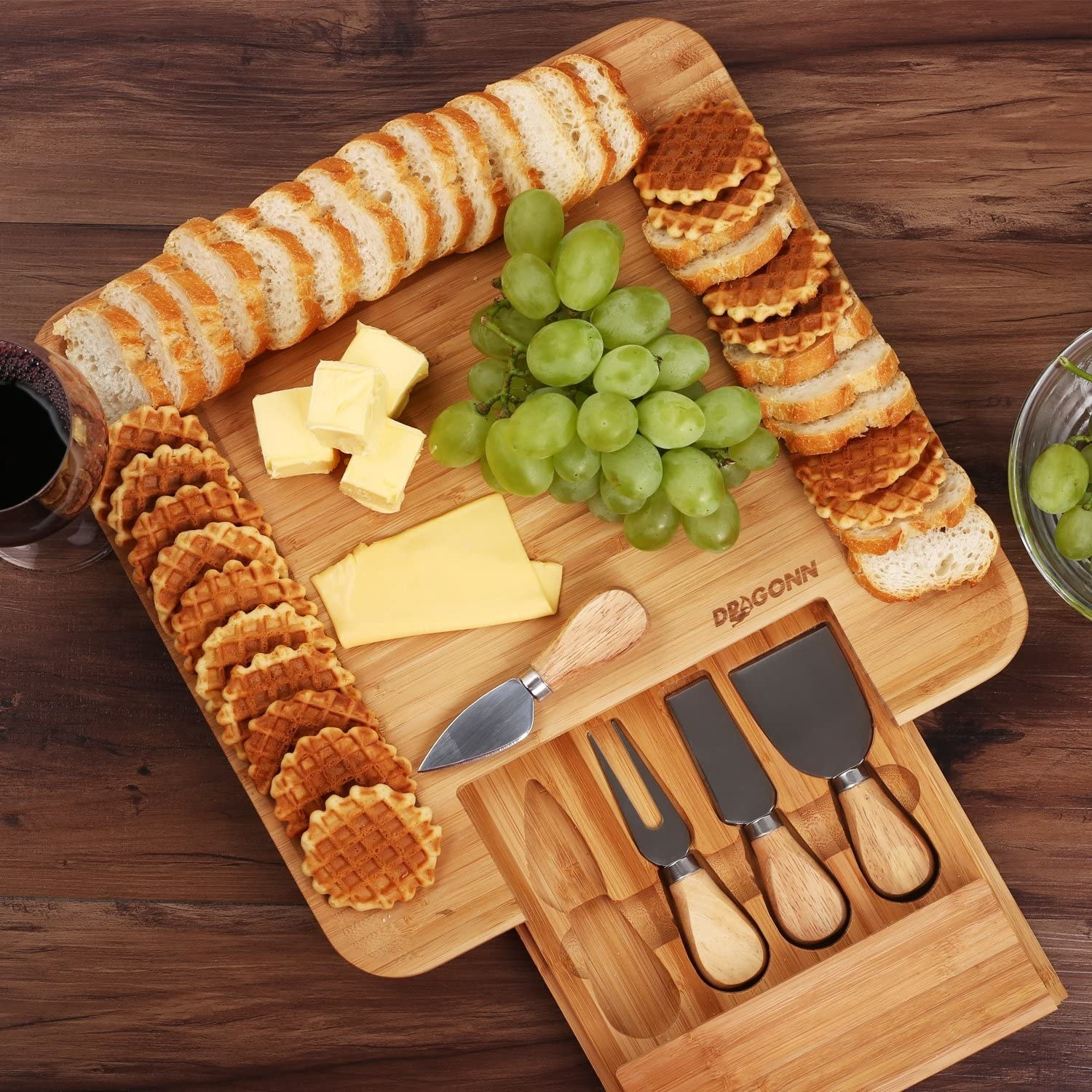 board with cheese, grapes, and crackers
