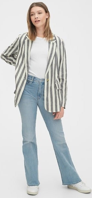 model in black striped blazer