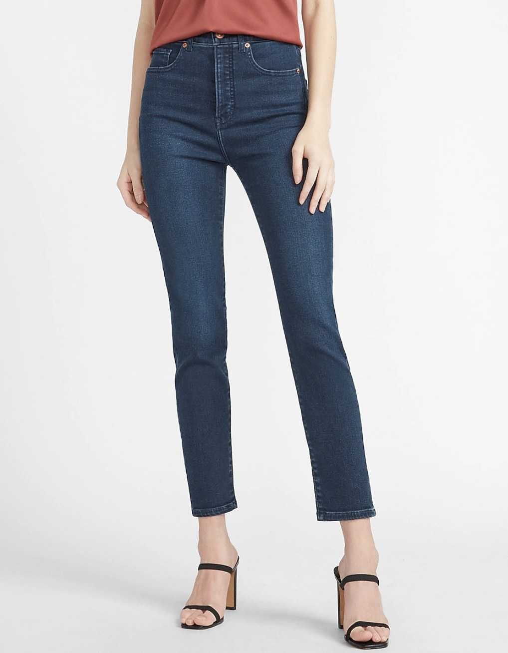 dark slim wash jeans with a pair of open-toe heels