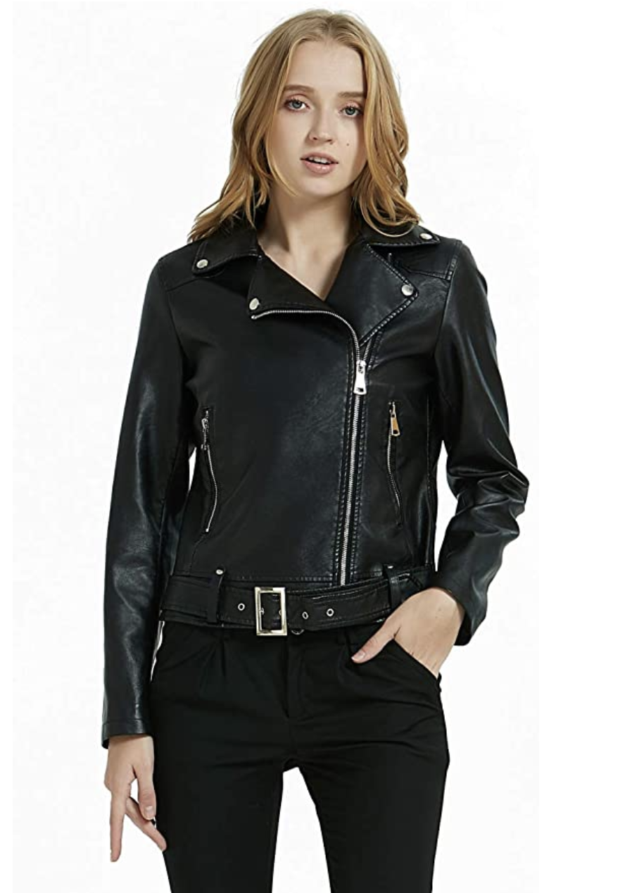 A model in a black zip up faux leather jacket with an asymmetrical front zip closure and belt at the bottom