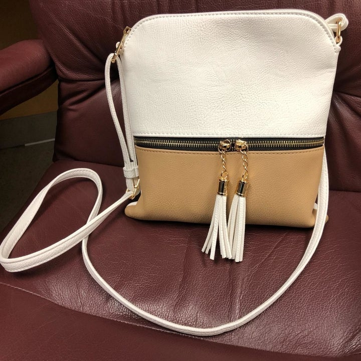reviewer's bag in cream and tan