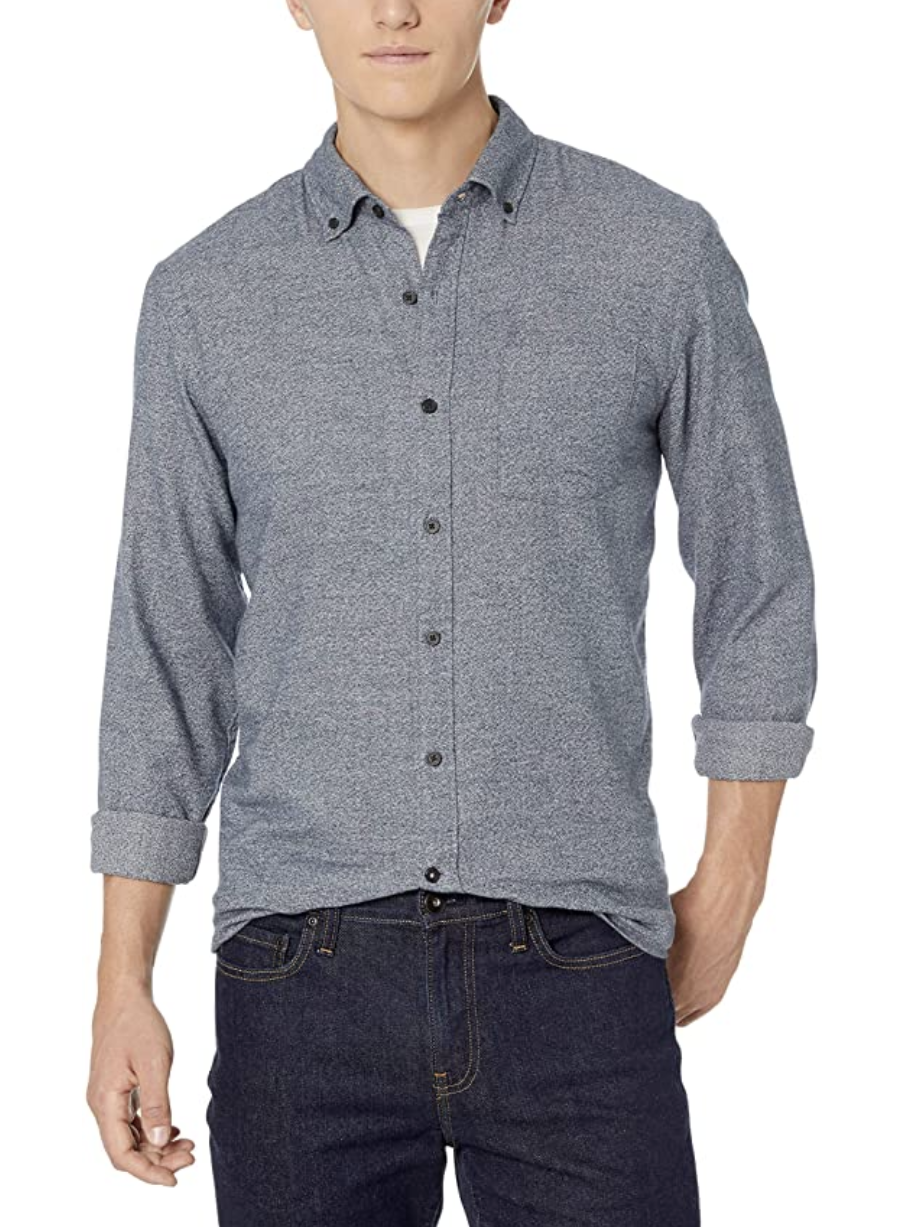 A model in a grey heathered button down long sleeve flannel shirt
