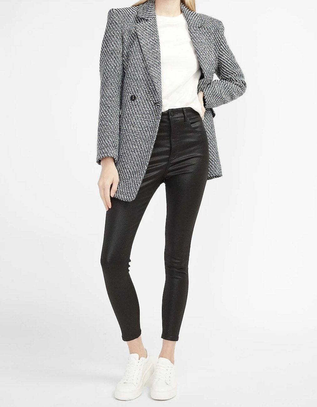 a black and white metallic blazer coat styled with a white t-shirt, leggings, and sneakers