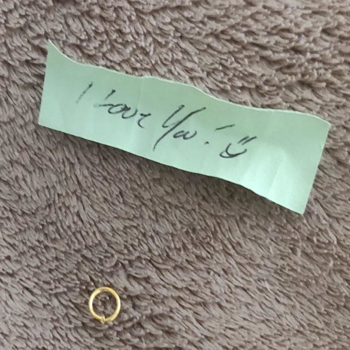 """A handwritten note from inside one of the capsules that says """"I love you!"""""""