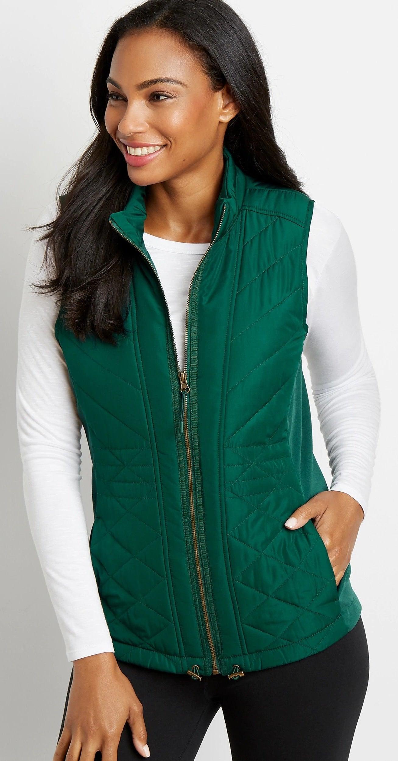 Model wearing green vest