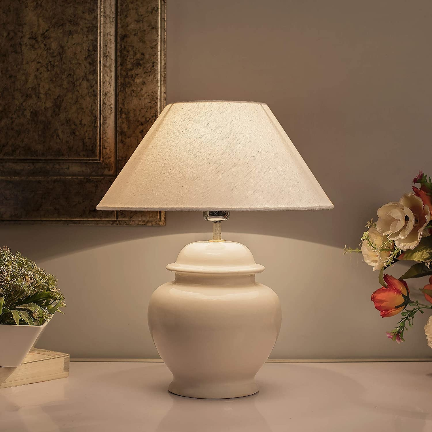 A traditional round lamp with a conical lampshade.