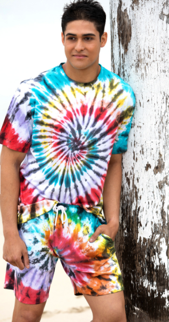 Man wearing a matching tie-dye shirt and shorts that are dyed in a spiralling pattern