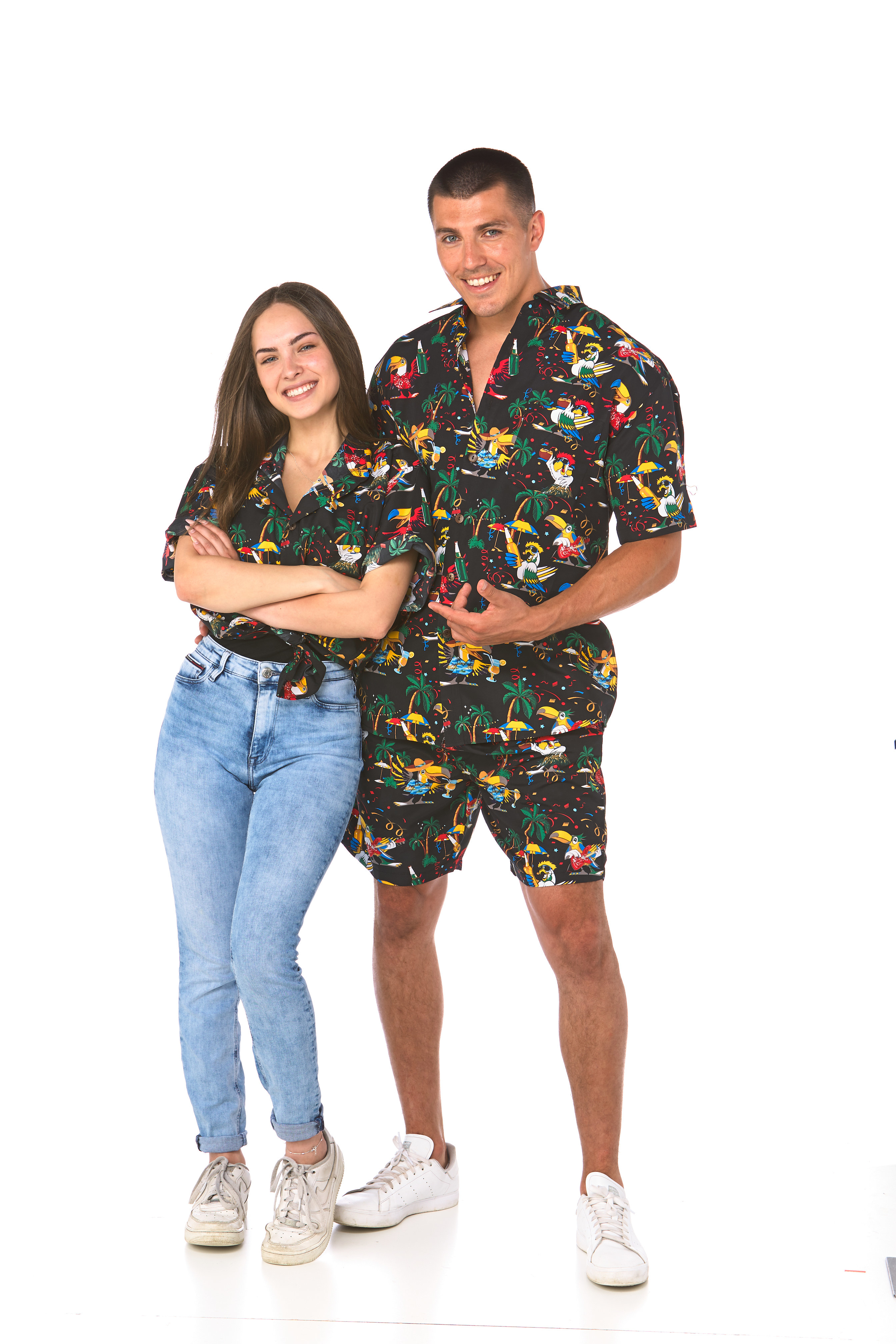 Man and woman wearing a dark shirt with parrots in various holiday scenarios