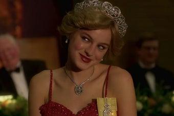 Diana wearing tiara and blushing and smiling