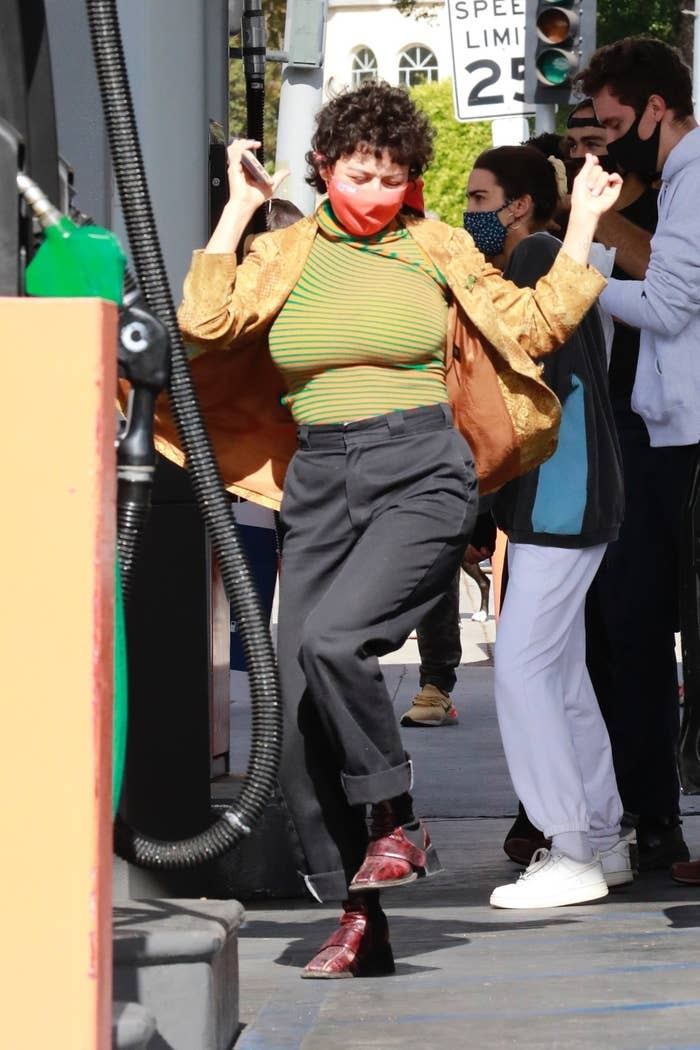 Actress Alia Shawkat celebrates Joe Biden's victory at a local gas station in Los Feliz. She drank champagne and danced with the crowd