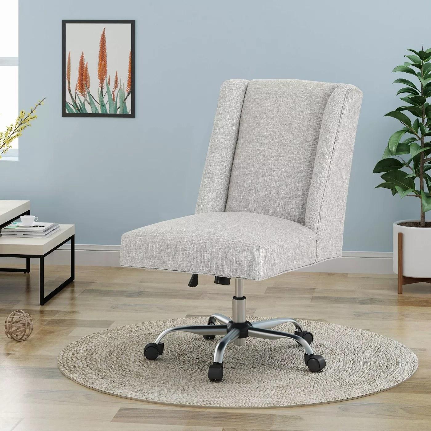 The swivel chair in beige