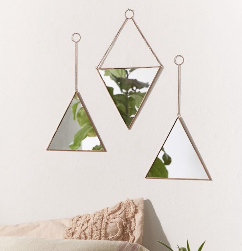 Three triangle mirrors on the wall