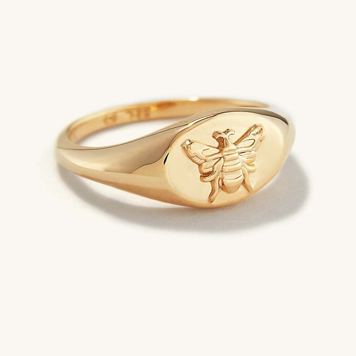 the gold ring with a bee design