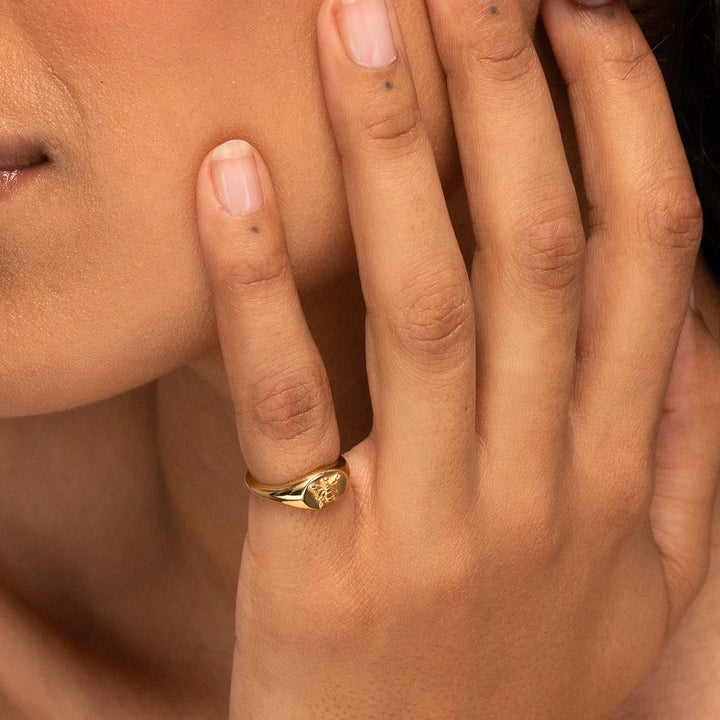 model wearing ring on pinky