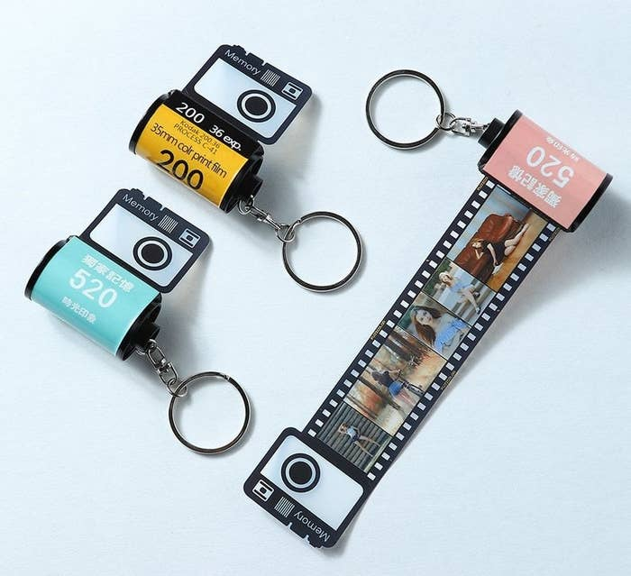 Tiny keychains with a film roll design. When you pull out the film, there is a strip of small customized photos