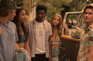 JJ, Kiara, Pope, Sarah, and John B standing outside a car