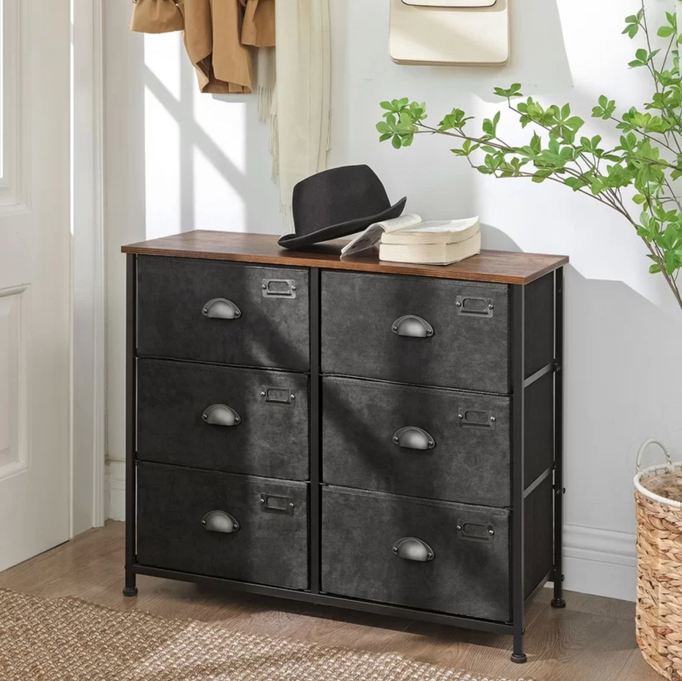The six drawer dresser in black with a wood top
