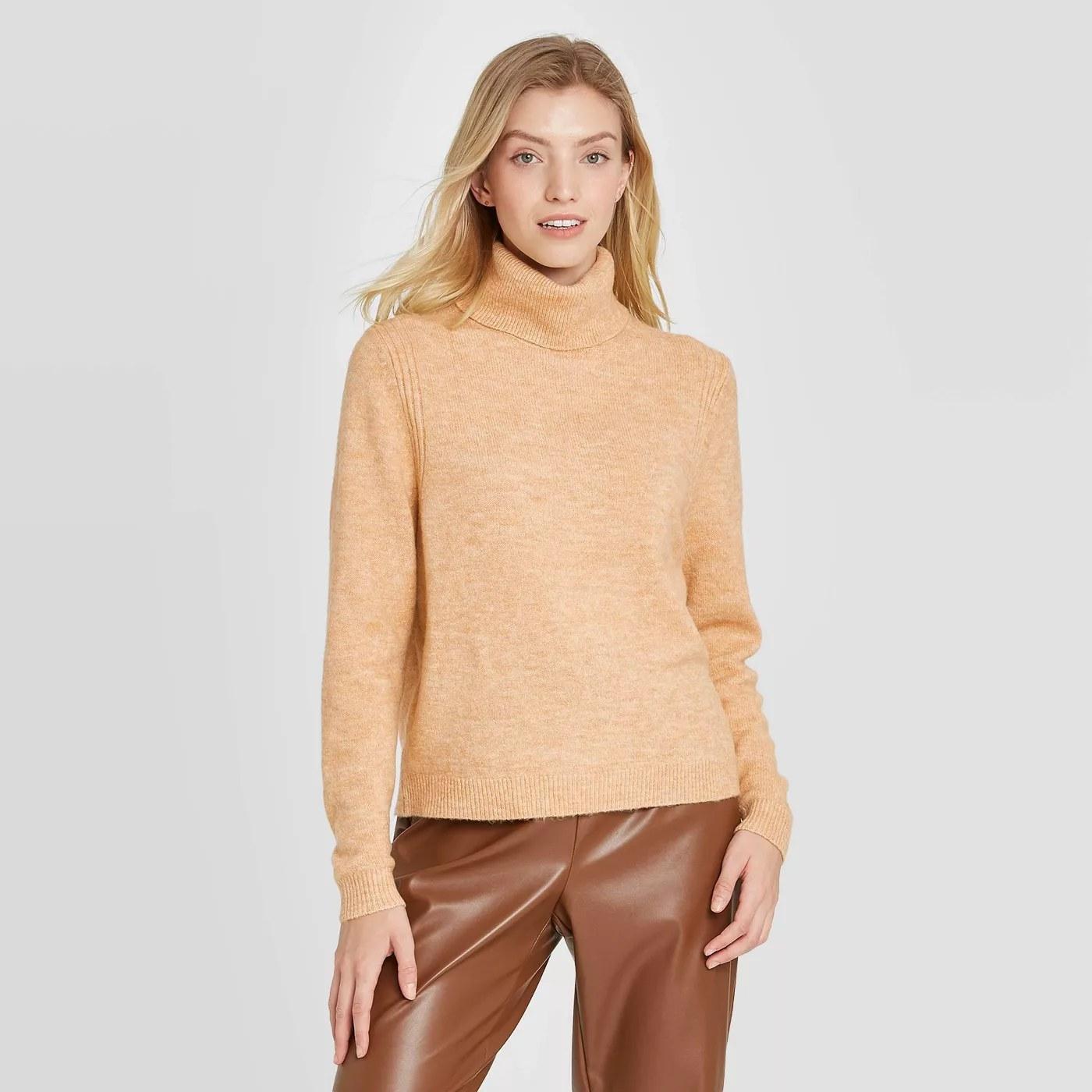 The sweater in beige