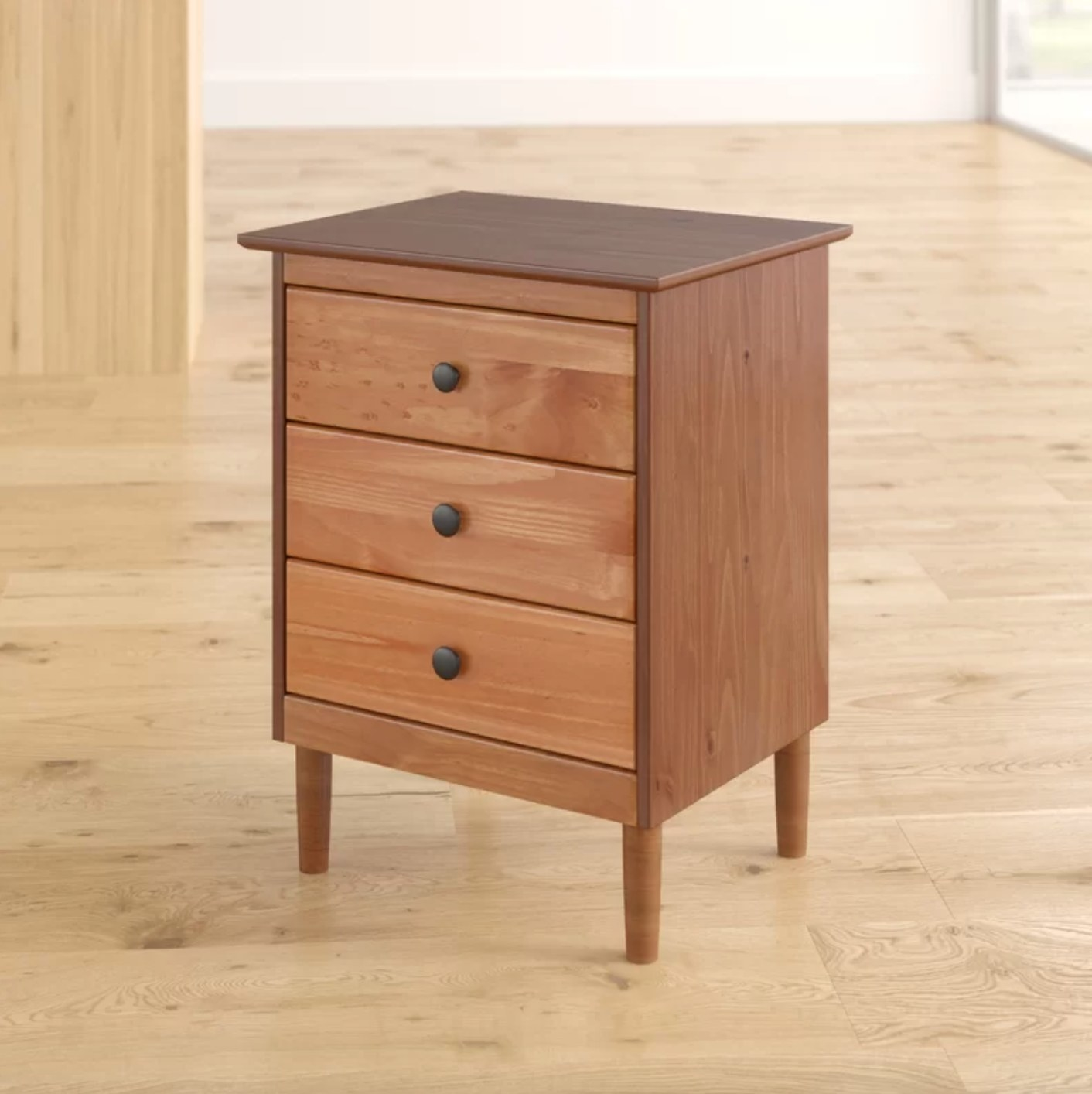 The three drawer nightstand in caramel