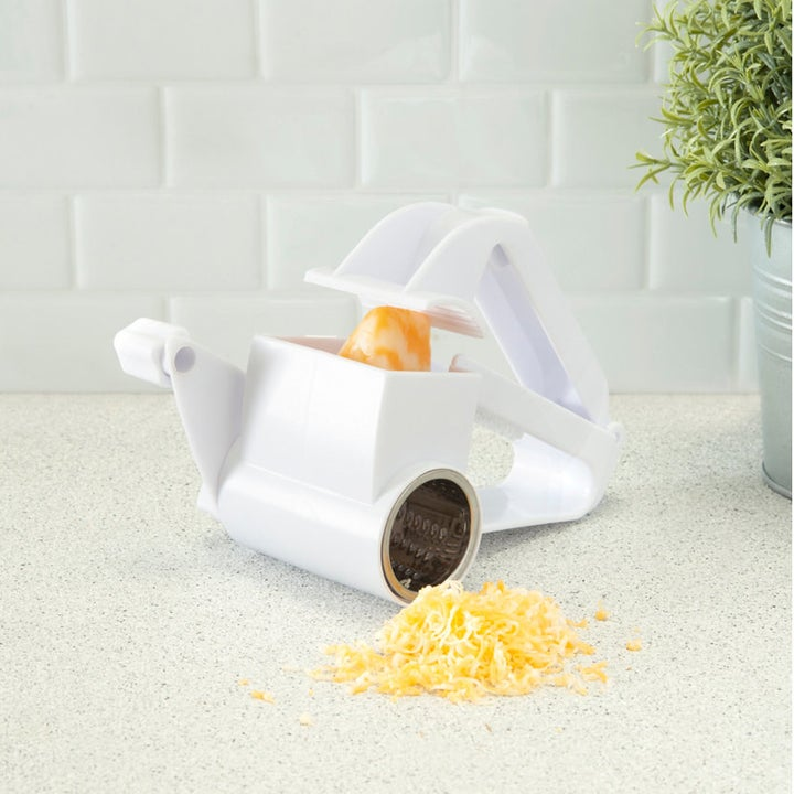 The grater with a block of cheese in it
