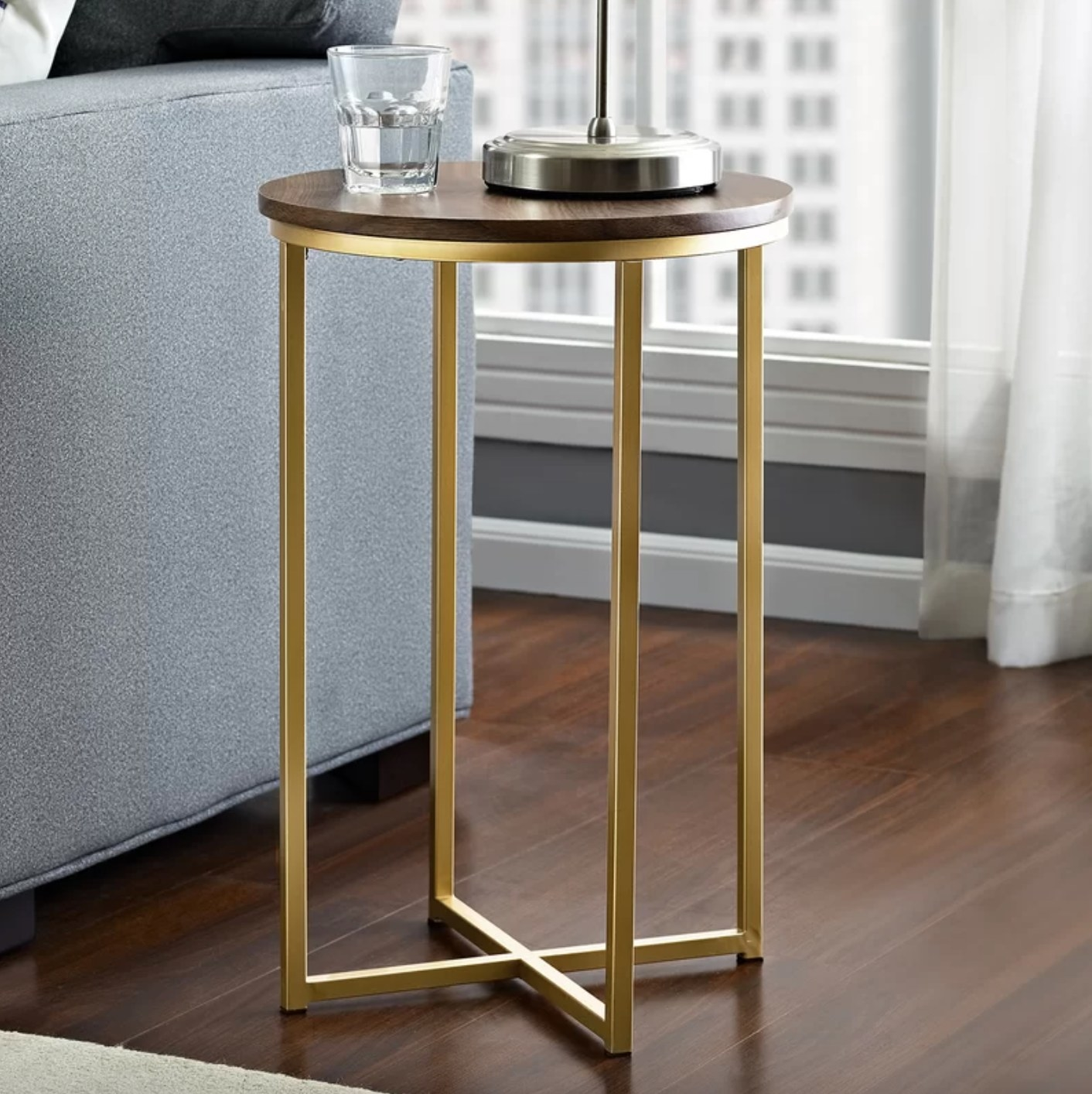 The end table in metal with a dark walnut wood top