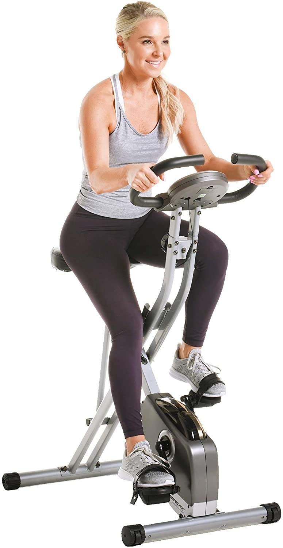 model on stationary exercise bike