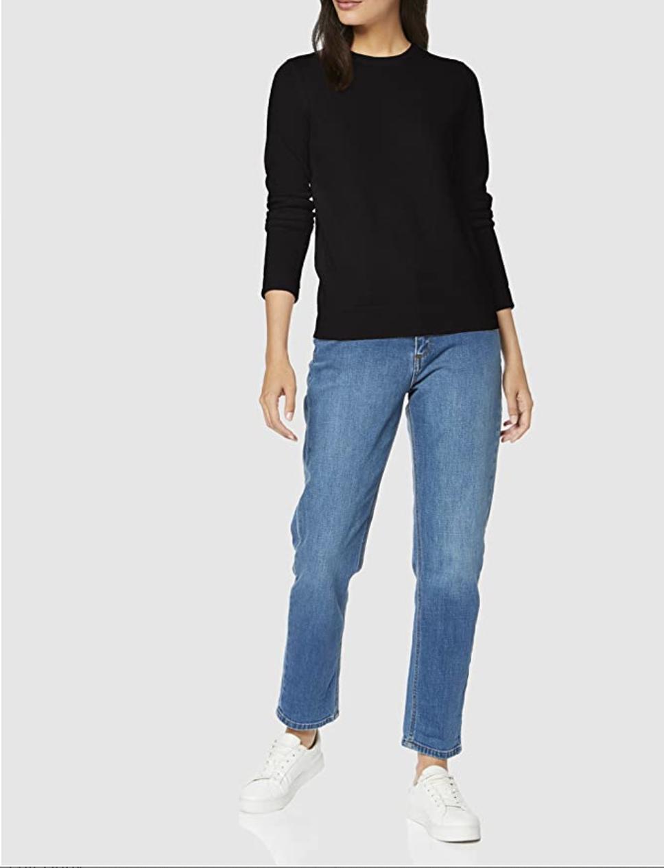 Model in a black cashmere crewneck sweater