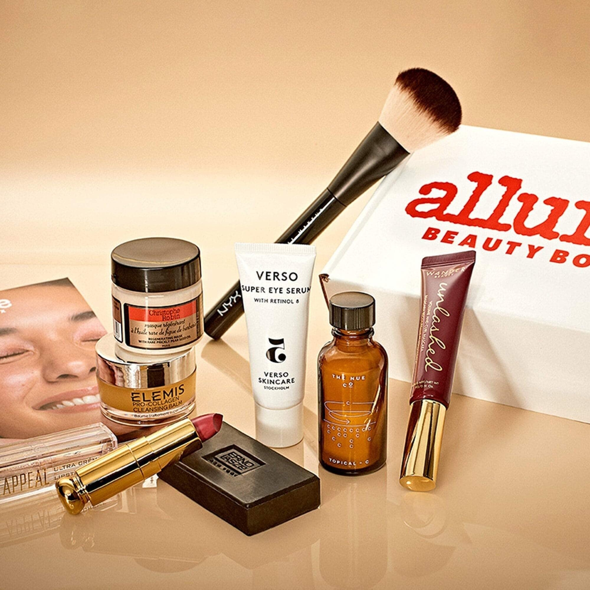 Contents of an allure beauty box with makeup, skincare, and other beauty items