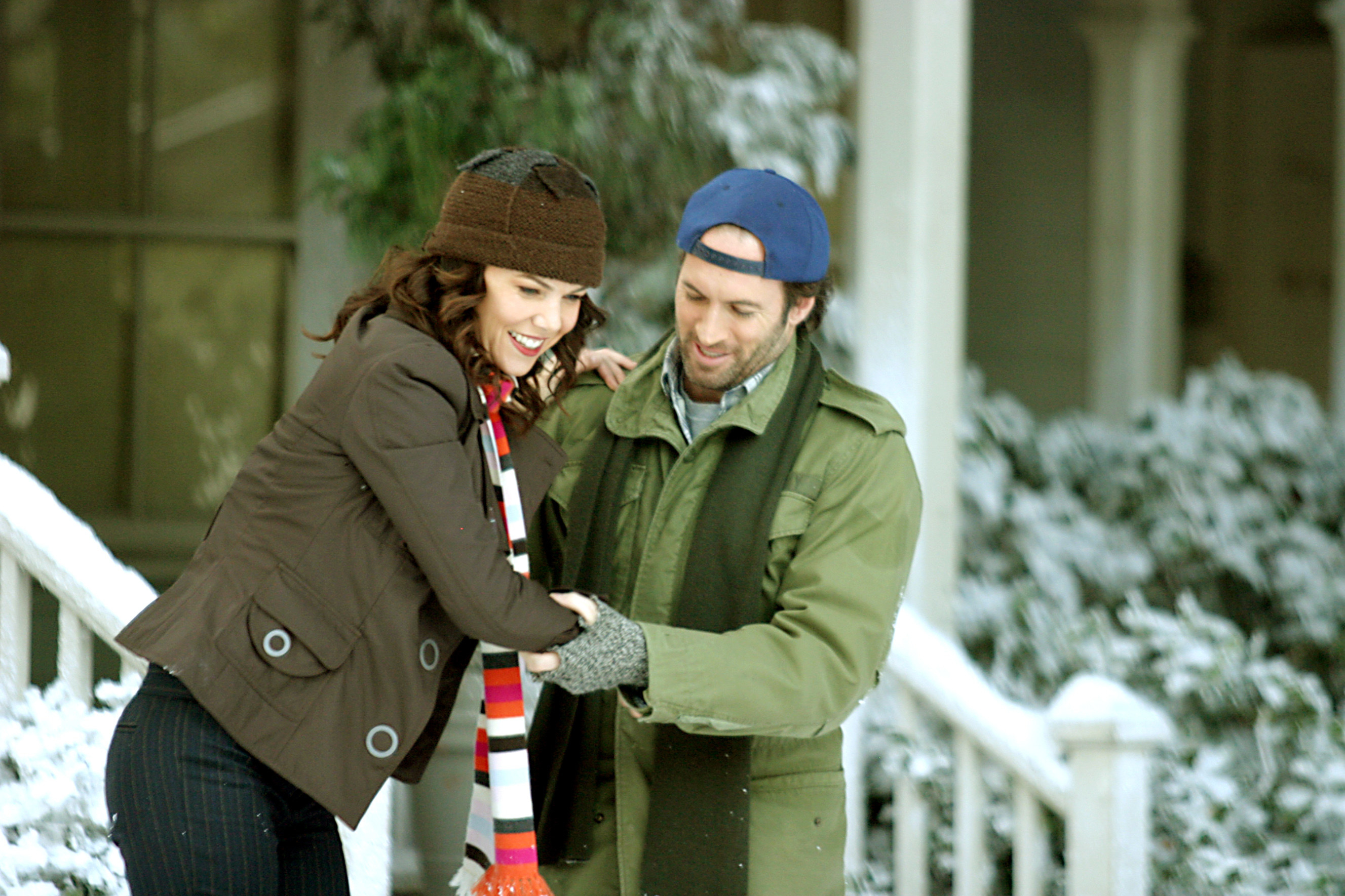 Scott Patterson helping Lauren Graham in a wintry scene