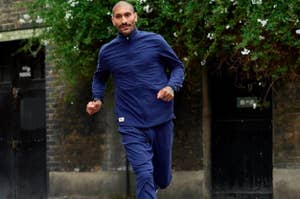 Model running in Tracksmith jacket and pants