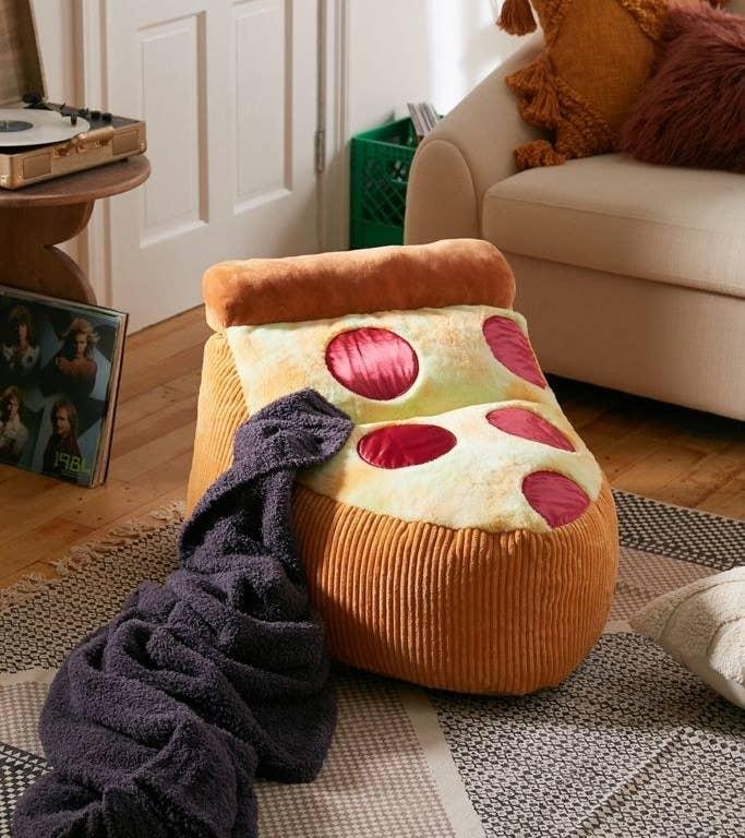 bean bag shaped like pepperoni pizza
