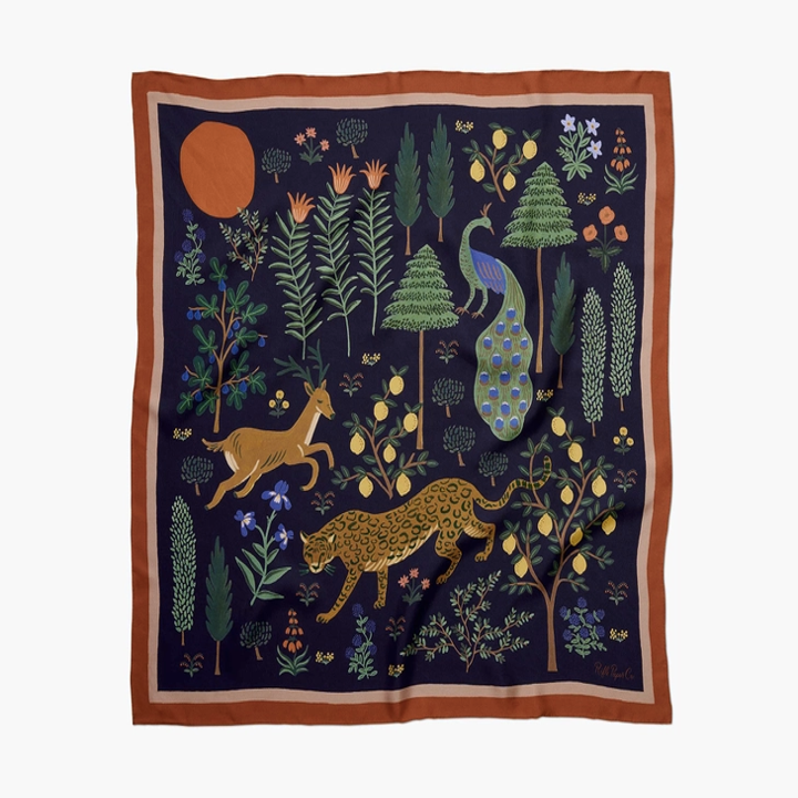 square scarf with leopard, deer, and peacock surrounded by trees
