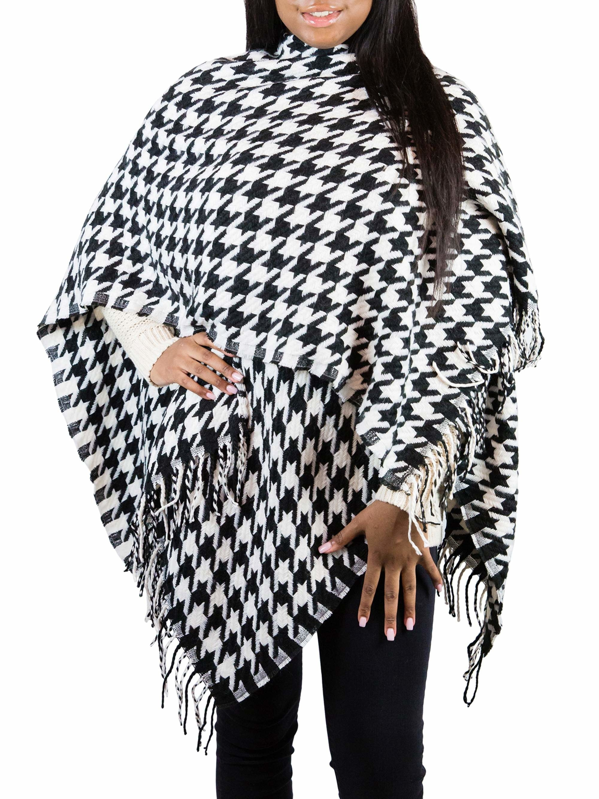 Model in the black and white frayed poncho