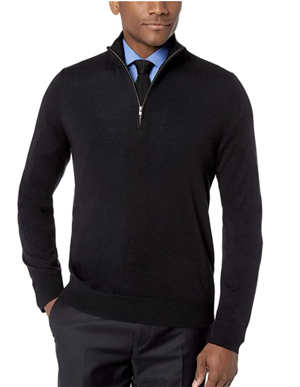model in a black quarter zip sweater