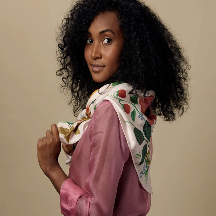 model wears floral scarf around shoulders