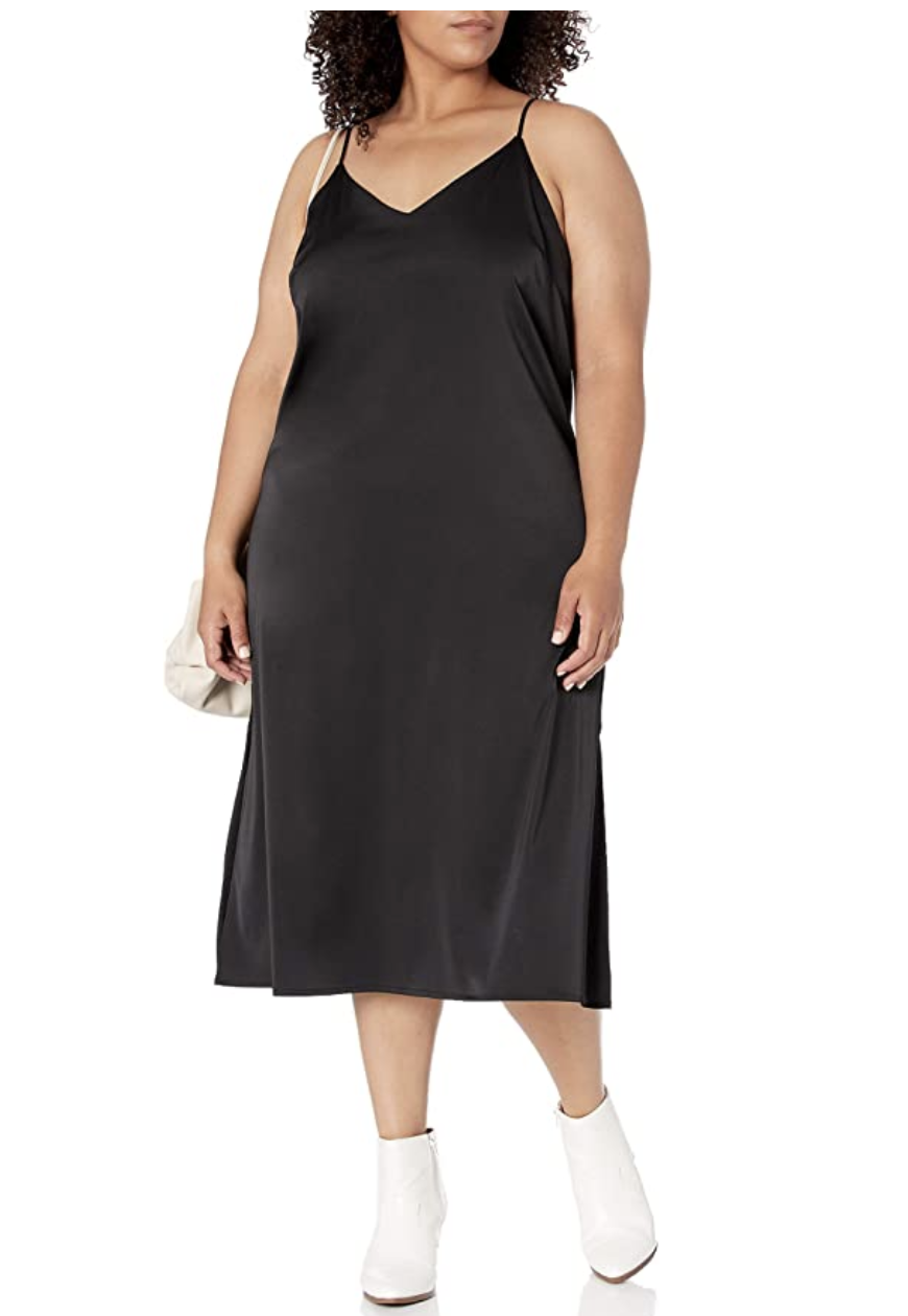 Model in the black version of the mid-length silky dress