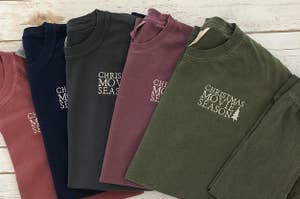 "an array of sweatshirts that say ""christmas movie season"" on them"