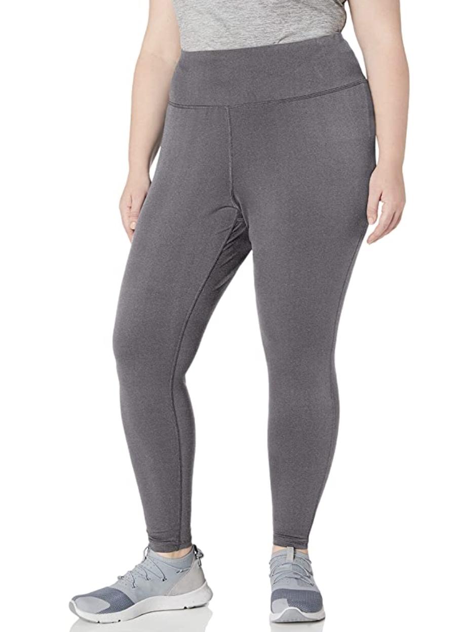Model in a pair of gray leggings
