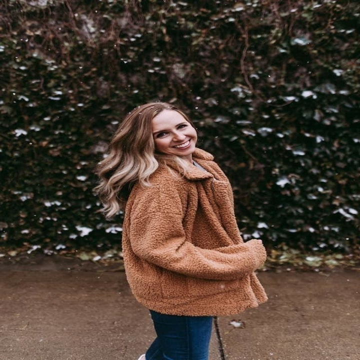 Reviewer wearing the tan teddy coat