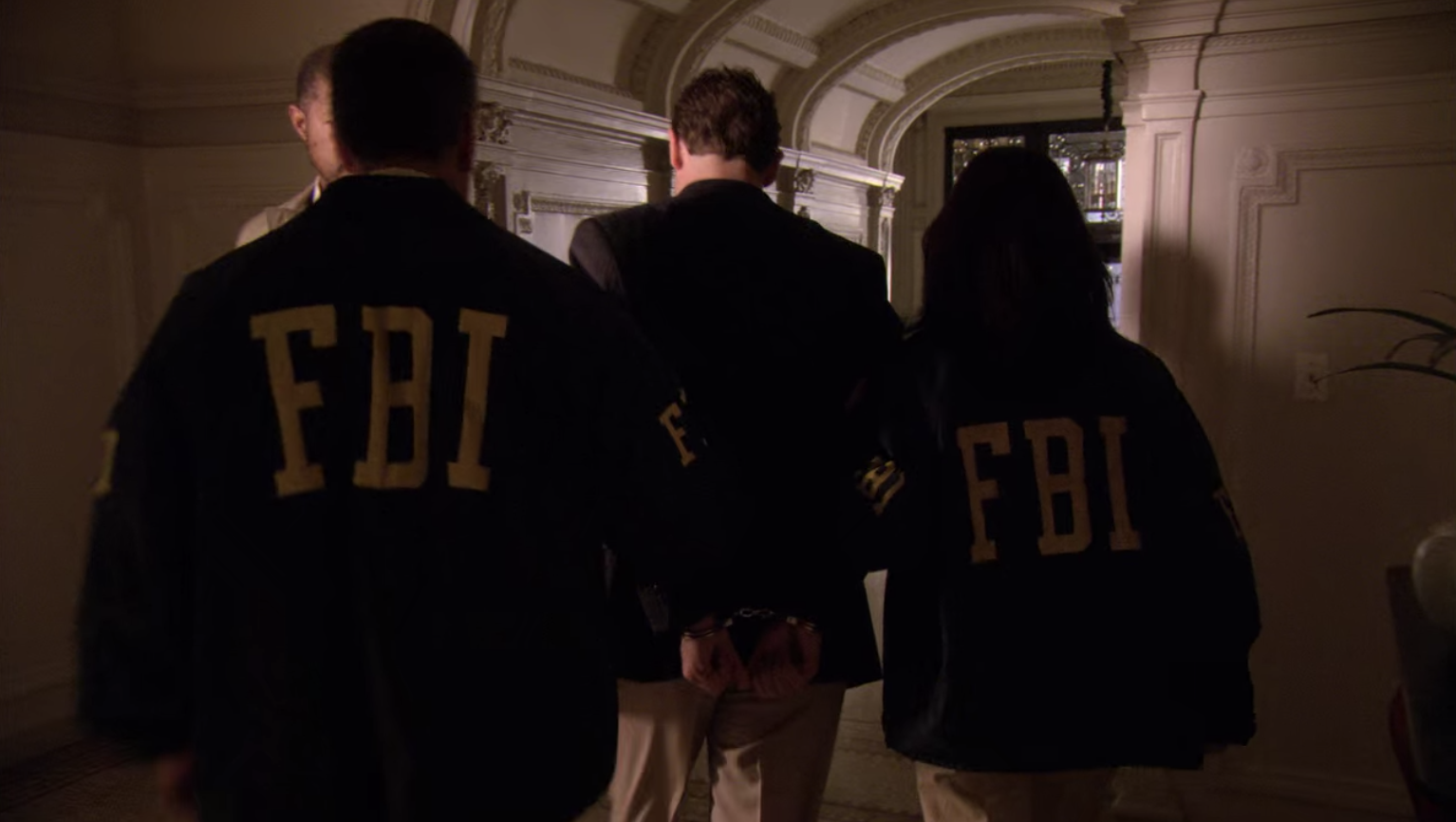 The Captain being escorted out by the FBI