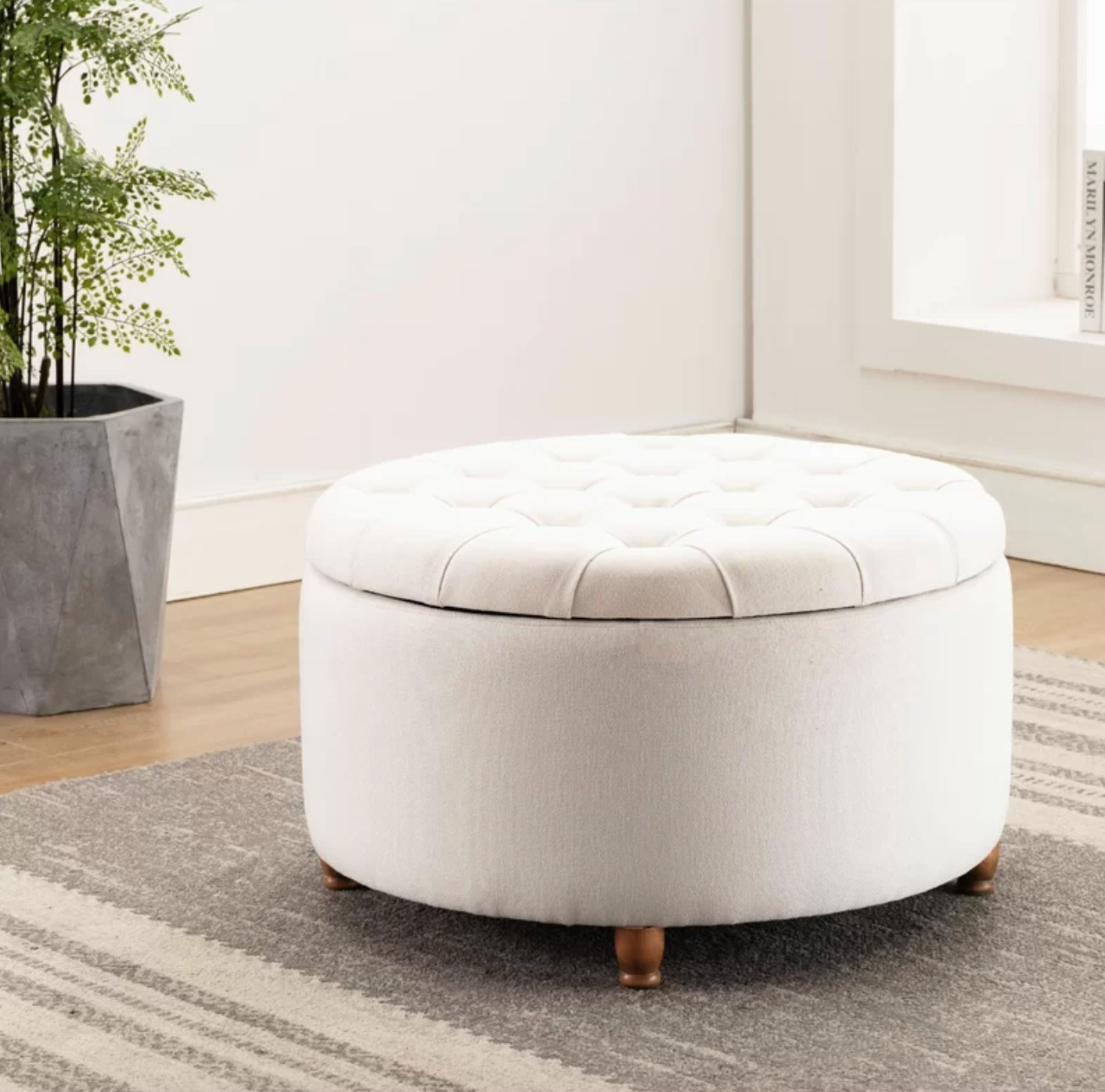 The tufted ottoman with storage in cream