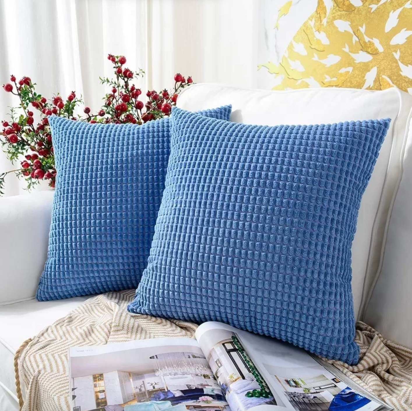 The set of two square pillow covers in pastel blue