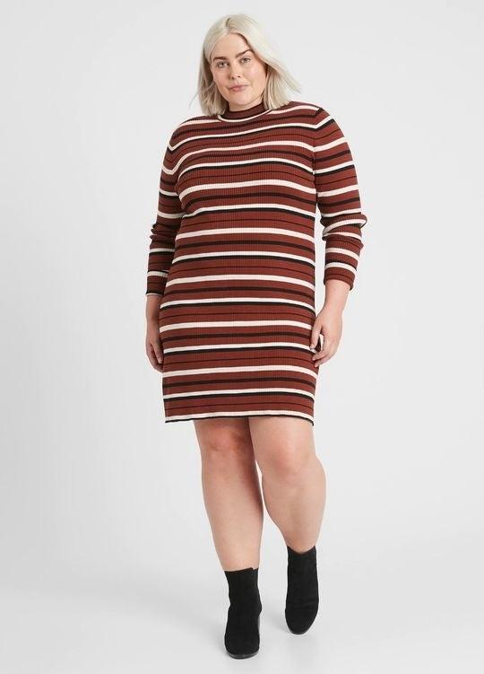 person wearing a striped turtleneck sweater dress